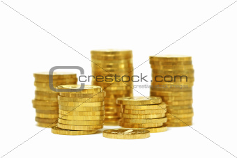 Piles of golden coins (isolated)