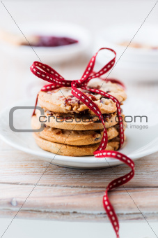 Cranberry and orange cookies tied with ribbon