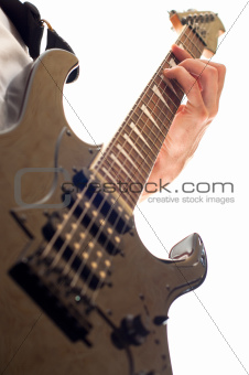 hand playing electric guitar