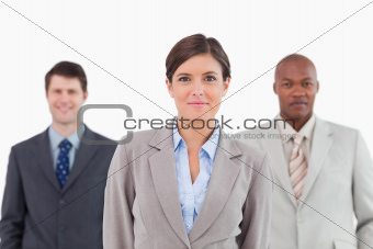 Three businesspeople standing together