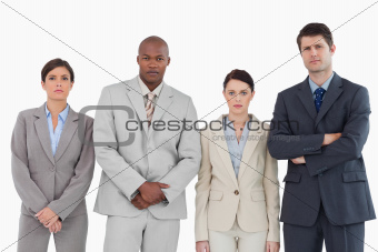 Four businesspeople standing together