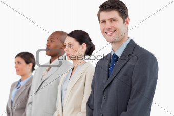 Smiling businessman standing next to his team
