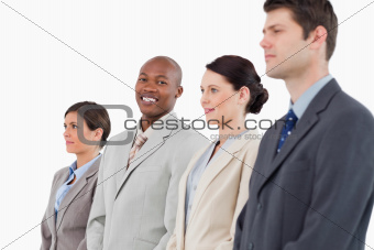 Smiling salesman standing between his colleagues