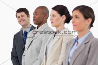 Smiling businessman standing next to his colleagues