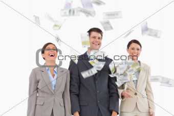 Money falling down on smiling businessteam