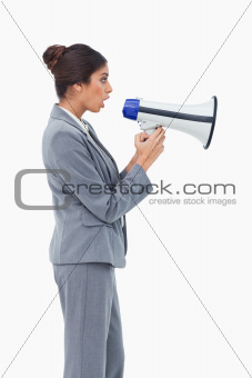 Side view of businesswoman using megaphone