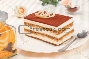 tiramisu cake and silver spoon