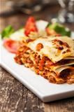 italian lasagna on a square plate