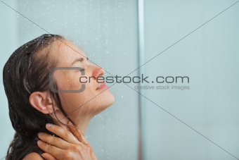 Portrait of woman taking shower