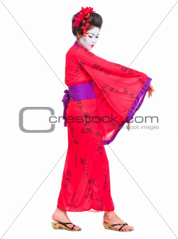 Full length portrait of geisha dancing isolated on white