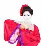 Portrait of geisha hiding behind fan isolated on white