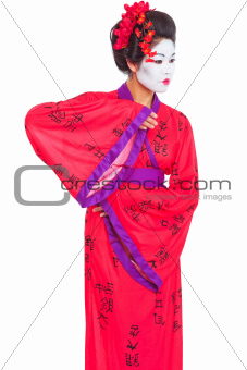 Portrait of geisha dancing isolated on white