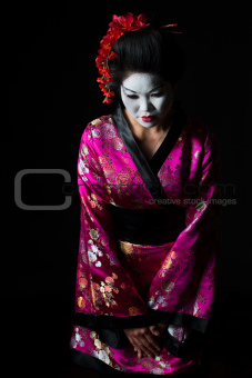 Portrait of geisha welcome with respect isolated on black