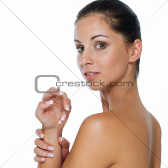Beauty portrait of girl showing well-groomed hands isolated on white