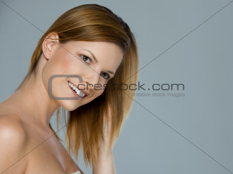 Beauty portrait of smiling girl isolated on gray