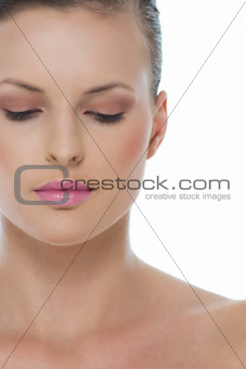 Beauty portrait of woman with closed eyes isolated on white