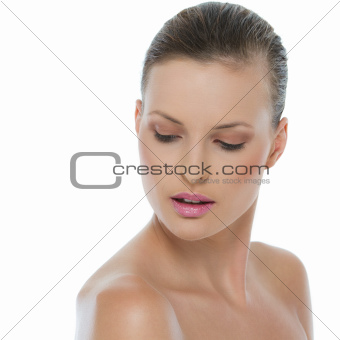 Beauty portrait of young woman looking down isolated on white