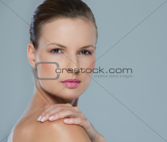 Beauty portrait of young woman isolated on gray