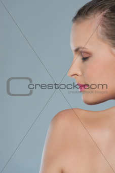 Beauty portrait of young woman in profile isolated on gray