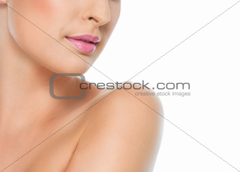 Closeup on female neck and mouth isolated on white
