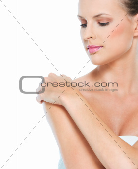 Beauty portrait of young woman looking on copy space isolated on white