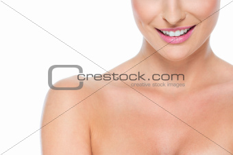 Closeup on smiling female lips isolated on white