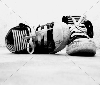 A pair of sneakers on the floor in black and white