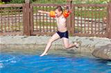 Boy jumps in the pool