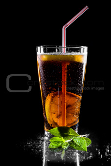 Iced tea beverage isolated on black background