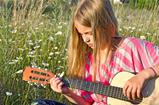 girl in daisies with guitar