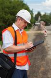 Engineer near the road repair work