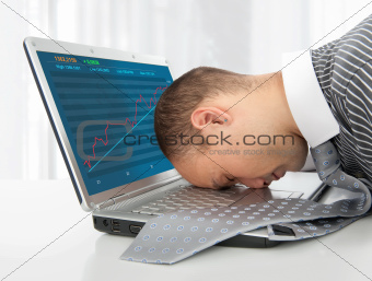 businessman sleeping on the laptop