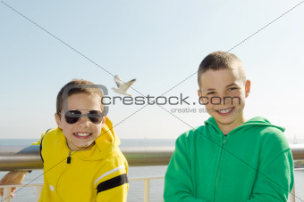 Two smiling boys on deck