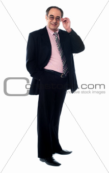 Old businessperson posing in style