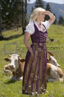 Young woman in dirndl on the farm