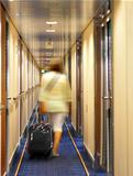 woman with suitcase in hotel