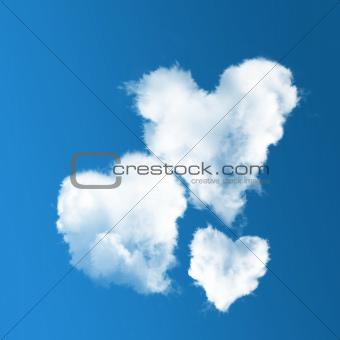 three heart-shaped clouds on blue sky