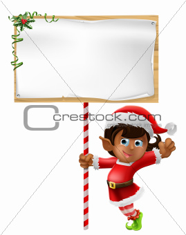Christmas elf holding a sign