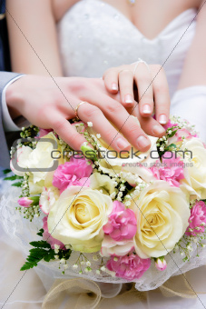 hands of newlyweds