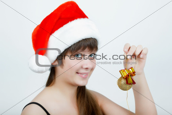 girl in a Christmas hat with Christmas decorations