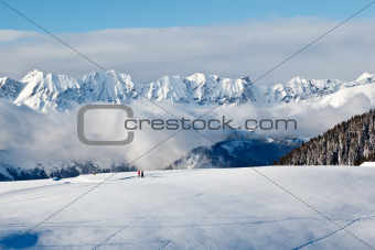 Panoramic View on Mountains and Two People Trekking in French Al