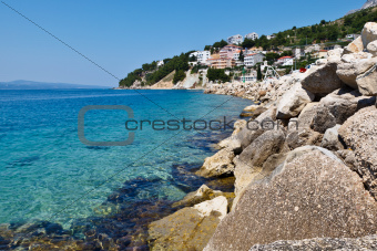 Blue Sea with Transparent Water and Rocky Beach in Croatia