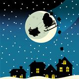 Santa claus flying over the city and dropping presents