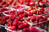 raspberries in a plastic boxes