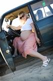 Pregnant woman in car