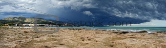Sea landscape with coast view. Storm sky with lightning, Panorama.