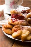 Sweet doughnuts with rose marmelade