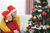 Young couple looking on Christmas tree