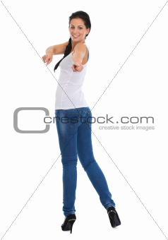 Full length portrait of happy girl pointing in camera