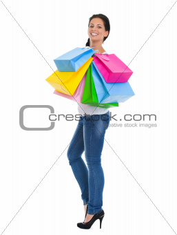 Full length portrait of happy girl with shopping bags
